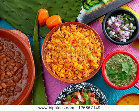 Mexican yellow rice with chilis and sauces frijoles beans