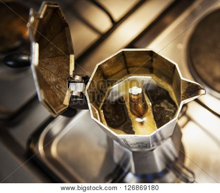 Coffeepot seen from above with coffee sprouting horizontal image