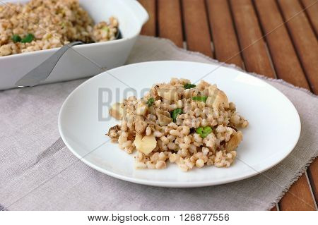 Oyster Mushroom With Barley Grouts And Spring Onion On The Plate
