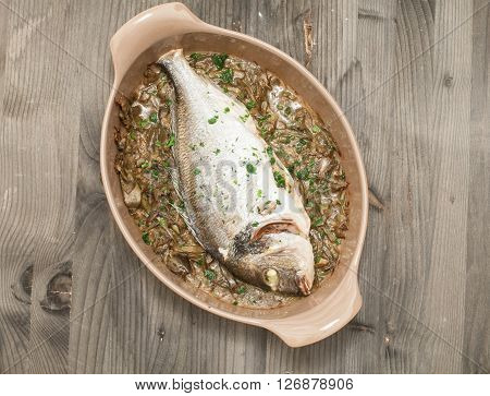 Fish cooked bream baked with stewed artichokesitaly