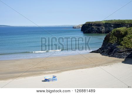 lonely wind breaker on the sandy beach in ballybunion county kerry ireland