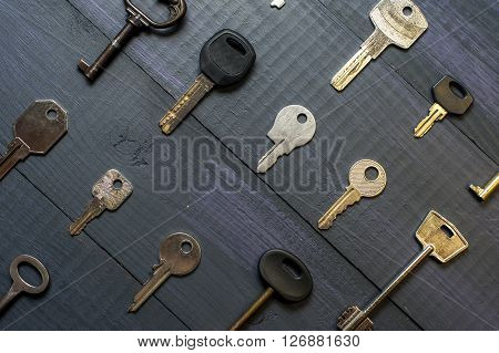 Keys collection on dark wooden table, horizontal view