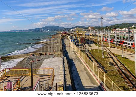 SOCHI, RUSSIA - OCTOBER 8: the Black sea coast and Adler railway station in OCTOBER 8, 2015, Sochi, Russia.