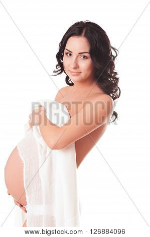 Smiling pregnant woman 20-25 year old naked over white. Holding white shawl. Looking at camera. Maternity. Motherhood.