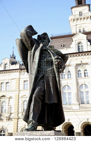 neo-classical architecture of City Hall in Novi Sad Serbia with Miletic national hero monument