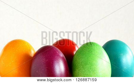 many various colorful easter eggs in row background