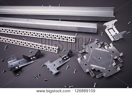 Profile for plasterboard, plasterboard fastening, set of building profiles, building materials, steel profiles for repair, construction works, modern building materials, screws for construction poster