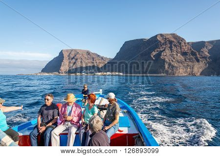 LA GOMERA, SPAIN - FEBRUARY 11. Tourists on excursion on board of a whale watching boat. The Oceano whale watching operator stands for respectful whale watching on the Atlantic on February 11, 2016