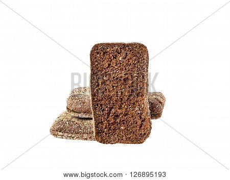 pieces of rye bread on white background, selective focus