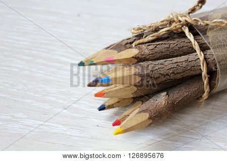 Wooden pencils on a white wooden table. poster
