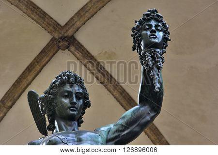 Bronze statue of Perseus holding the head of Medusa in Piazza della Signoria square (Florence) made by famous artist Benvenuto Cellini in 1545
