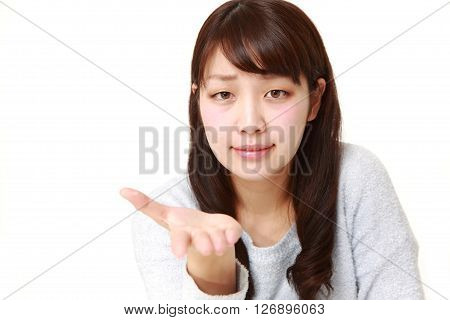 angry young Japanese woman requests something on white background