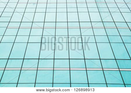 Green blue mirror window of the high office building - abstract underside angle view perspective for background