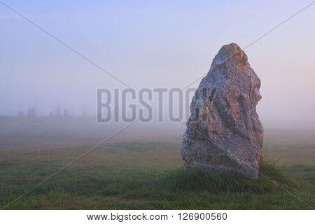 Single Menhir View At Camaret Sur Mer At Sunrise During Fog