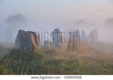 Menhir Alignment View At Camaret Sur Mer At Sunrise During Fog