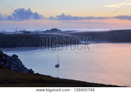 Yacht On Anchor At Sunrise In Celtic Sea At The Coast Of Brittany