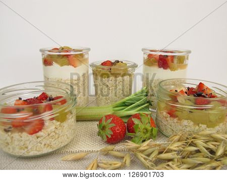 Overnight-Oats with quark, rhubarb, strawberries and cocoa nibs