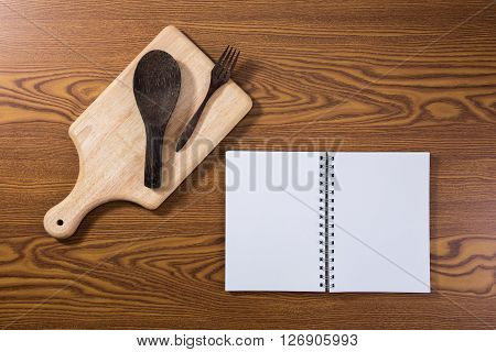 top view of recipe book with cooking stuff