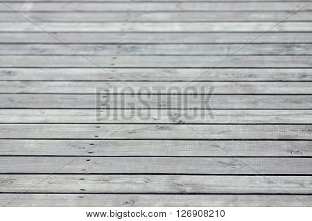 vague gray texture of a floor from wooden boards for an abstract background