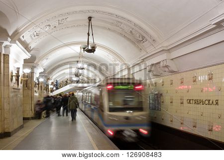 MOSCOW - MARCH 3: Blurred people and train at Oktyabrskaya metro station on March 3 2016 in Moscow. The station is named after the Taganka Square which is a major junction of the Sadovoye Koltso.