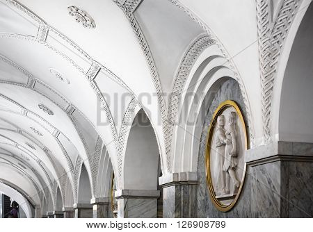 MOSCOW - MARCH 3: Closeup of architecture details of the Park Kultury metro station on March 3 2016 in Moscow. Decoratively the station contains 26 circular bas-reliefs by Iosif Rabinovich.