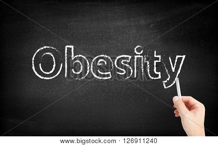Obesity written on white blackboard