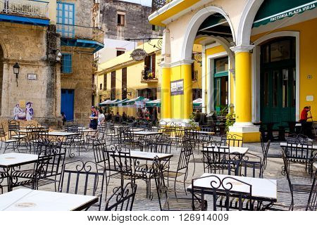 HAVANA,CUBA- APRIL 20,2016 :  Outdoor cafe at Plaza Vieja in the colonial neighborhood of Old Havana