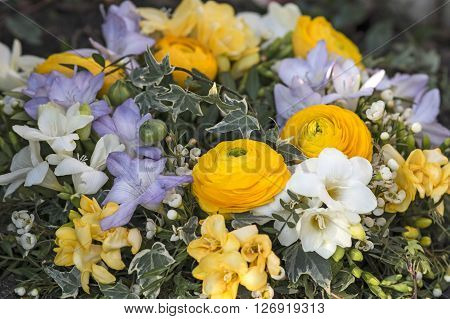 A flower Bouquet with freesia and ranunculus