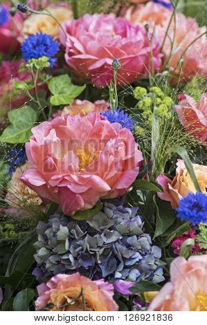 Flower Bouquet with peonies in pink  and cornflowers