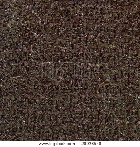 Olive yellow woven woolen fabric texture. Complicated melange. Close up fragment of the top view.