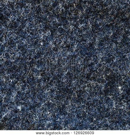 Cobalt blue melange fuzzy woolen cloth texture. Close up fragment of the top view.