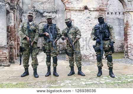 MILOT, HAITI - NOV 17, Fully armed soldiers guarding Sans Souci palace during president Michel Martelly visit on November 17, 2013 in Milot, Haiti