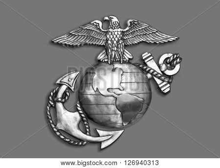 Marine eagleglobe and anchor brass emblem in black and white.