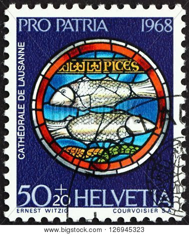 SWITZERLAND - CIRCA 1968: a stamp printed in the Switzerland shows Pisces Design from Rose Window Lausanne Cathedral circa 1968