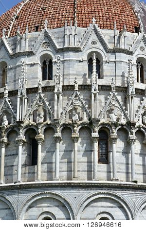 Details from the famous Pisa Baptistry show the transition between romanesque and gothic style