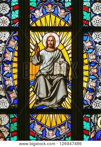 Stained Glass - Jesus Holding The Holy Bible