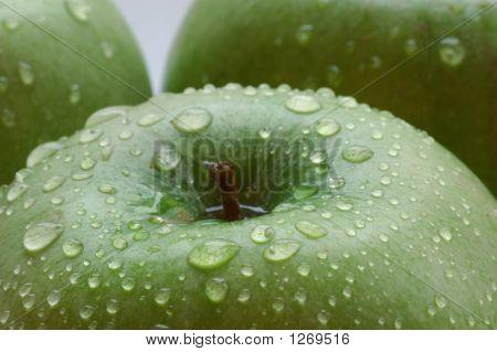 Water Drop On An Apple Closeup