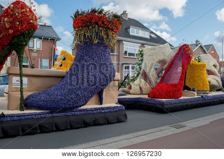 HILLEGOM, THE NETHERLANDS - APRIL 23, 2016: Moving platform with a frame made in a form of boots and shoes decorated with spring flowers. Taking part in the  traditional flowers parade