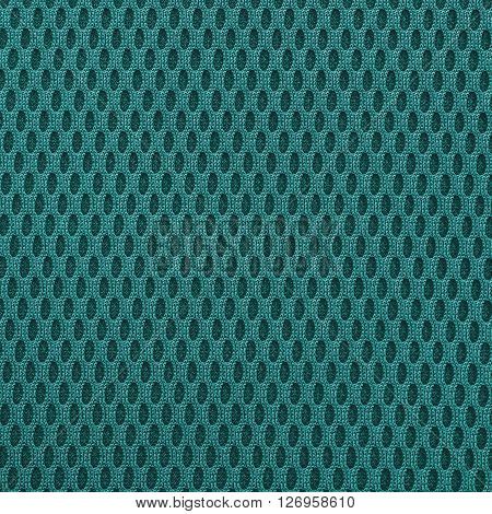 Turquoise teal multilayer fiber fabric texture. Close up top view.