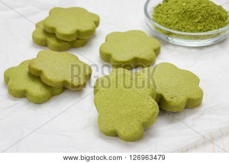 Homemade matcha green tea shortbread cookies on parchment
