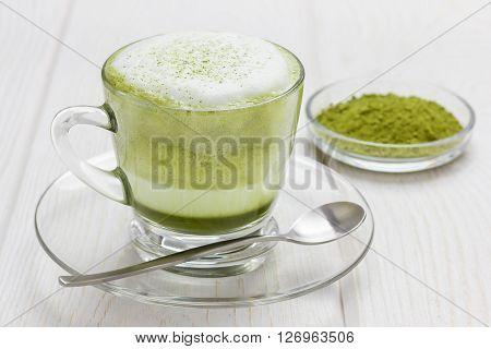 Matcha gren tea latte in glass cup