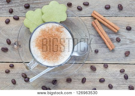 Coffee latte in glass cups with matcha cookies top view