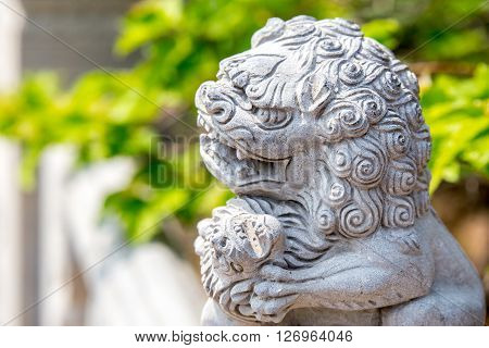 Laoshan China 21/04/2016 Fierce stone lion figure outside handrail decoration in a temple in LaoshanChina on a sunny day