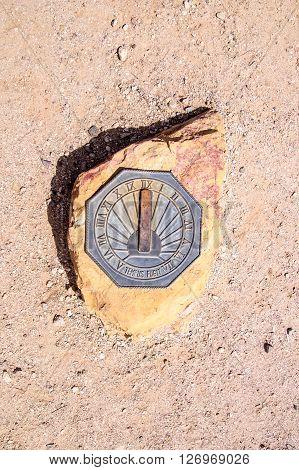 Sun dial on rock in the Arizona desert