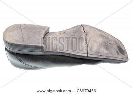 Damaged sole of a black shoe isolated