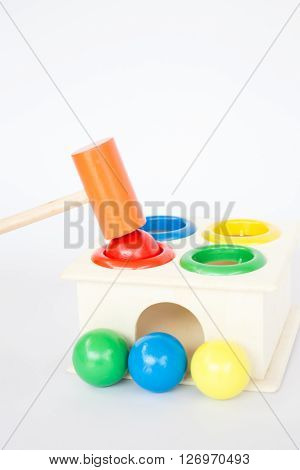 Colorful hammer case wooden toy on white table stock photo