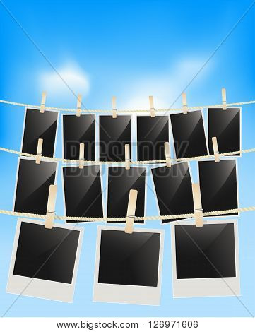 Photo frames hanging on clothesline with clothespins on blue sky background . Blank retro photographic frames. vector