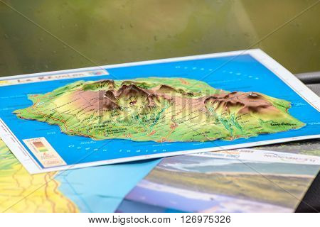 La Reunion France - December 24 2015: Three-dimensional map of the island of Reunion in the tourist bus La Reunion Island France.