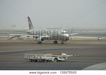 ABU DHABI, UAE - MARCH 10, 2015: Airbus A320-232 (A6-EIR) company Etihad Airways after landing at the airport in Abu Dhabi