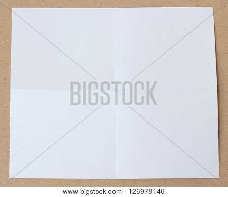 close up of a crumpled unfolded piece of white paper